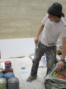 Adam Buehler selects a color and contemplates the next step for his abstract painting.