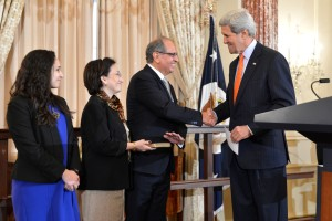 Arnold Chacon with his family and Secretary of State John Kerry.