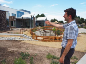 Joshua Pruyn points out outdoor spaces at the campus.